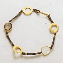 DISCS AND STONES LEATHER BRACELET